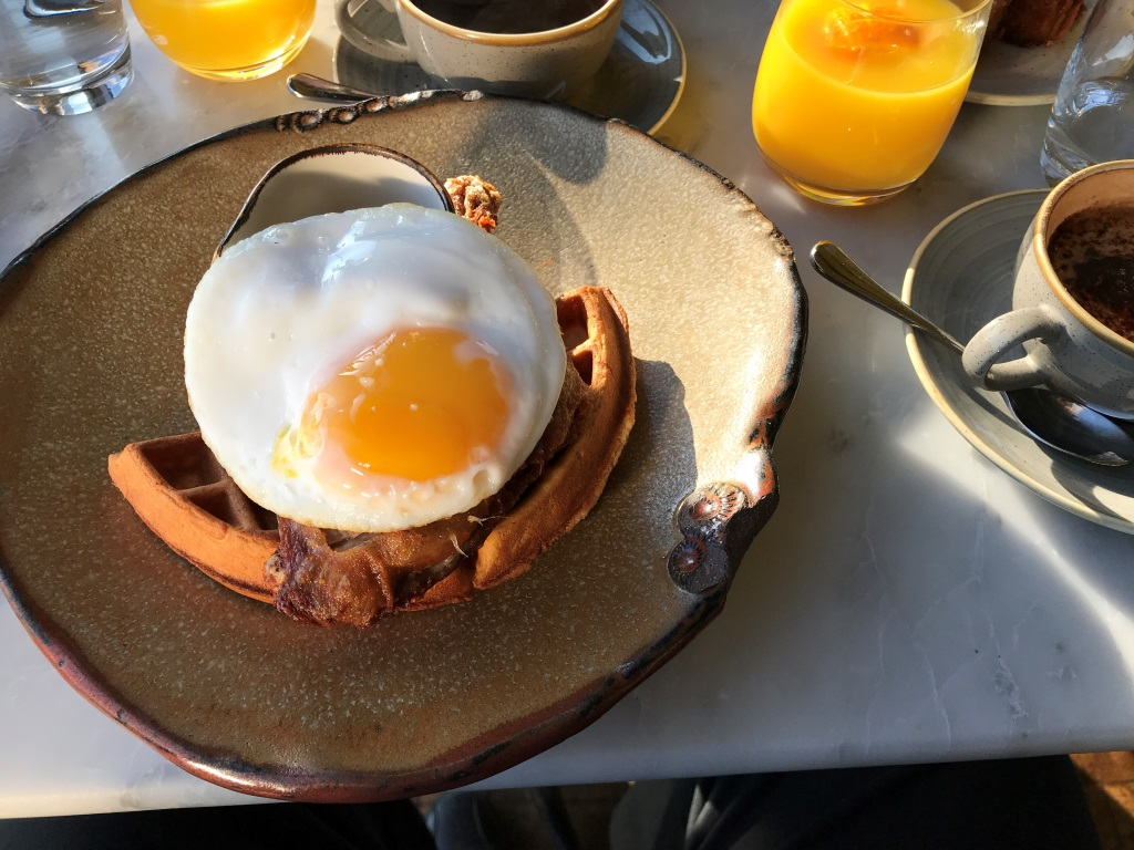 Duck leg, duck egg, and a waffle